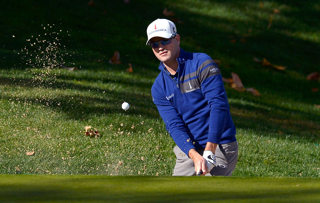 . Zach Johnson hits out of a greenside bunker on the fourth hole during the final round of the Northwestern Mutual World Challenge golf tournament at Sherwood Country Club, Sunday December 8, 2013, in Thousand Oaks, Calif.(Andy Holzman/Los Angeles Daily News)