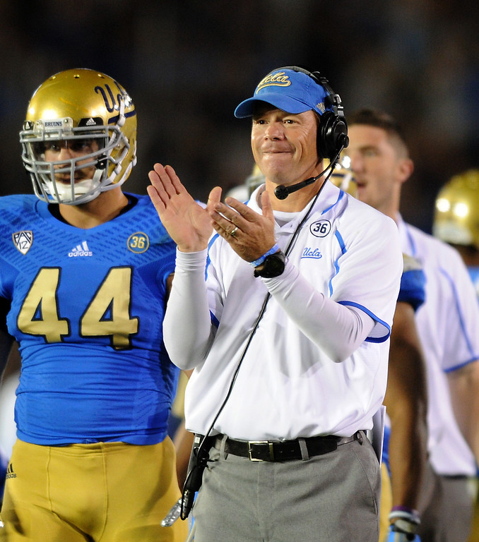 . UCLA head coach Jim Mora applauds a third-quarter touchdown against Colorado, Saturday, November 2, 2013, at the Rose Bowl. (Photo by Michael Owen Baker/L.A. Daily News)