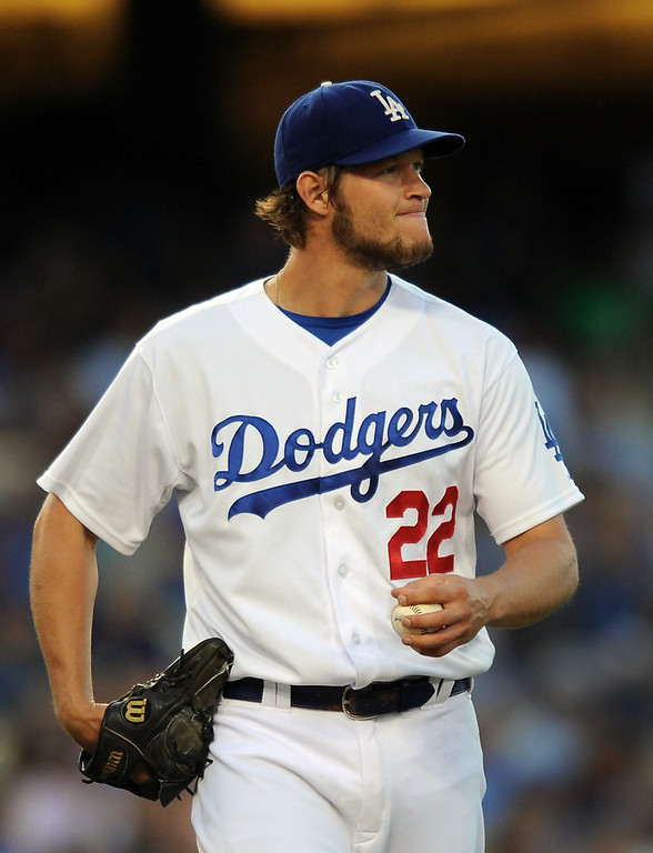 . Dodgers starting pitcher Clayton Kershaw makes a face after giving up a leadoff double in the second inning against the Rockies, Friday, July 12, 2013, at Dodger Stadium. Rockies won 3-0.   (Michael Owen Baker/Los Angeles Daily News)