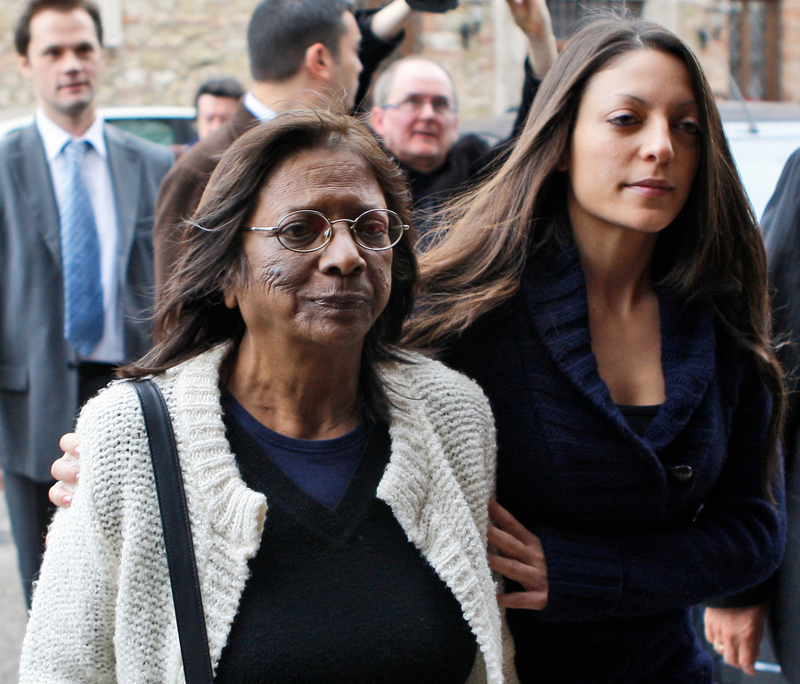 . From left, Stephanie Kercher, sister, right, and Arline Kercher, mother of slain British student Meredith Kercher walk outside an hotel at the end of a press conference in Perugia, Italy, Saturday, Dec. 5, 2009. The family of Meredith Kercher  said they were pleased with the murder conviction of American student Amanda Knox but said there was no sense of celebration. A jury in Italy convicted Amanda Knox of murdering her British roommate Meredith Kercher and sentenced her to 26 years in prison shortly after midnight Saturday. Her Italian ex-boyfriend Raffaele Sollecito was also convicted and sentenced to 25 years. (AP Photo/Luca Bruno)