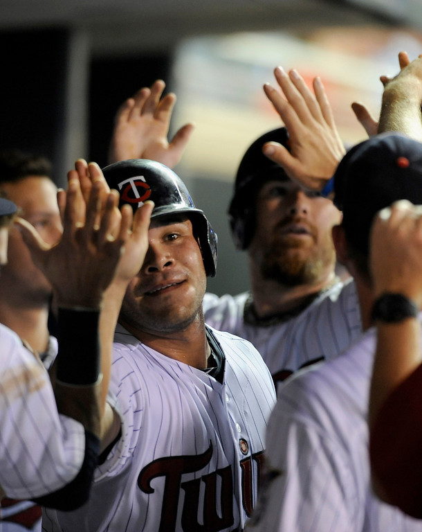 . MINNEAPOLIS, MN - SEPTEMBER 9: Josmil Pinto #43 and Ryan Doumit #9 of the Minnesota Twins celebrate scoring against the Los Angeles Angels of Anaheim during the fifth inning of the game on September 9, 2013 at Target Field in Minneapolis, Minnesota. (Photo by Hannah Foslien/Getty Images)