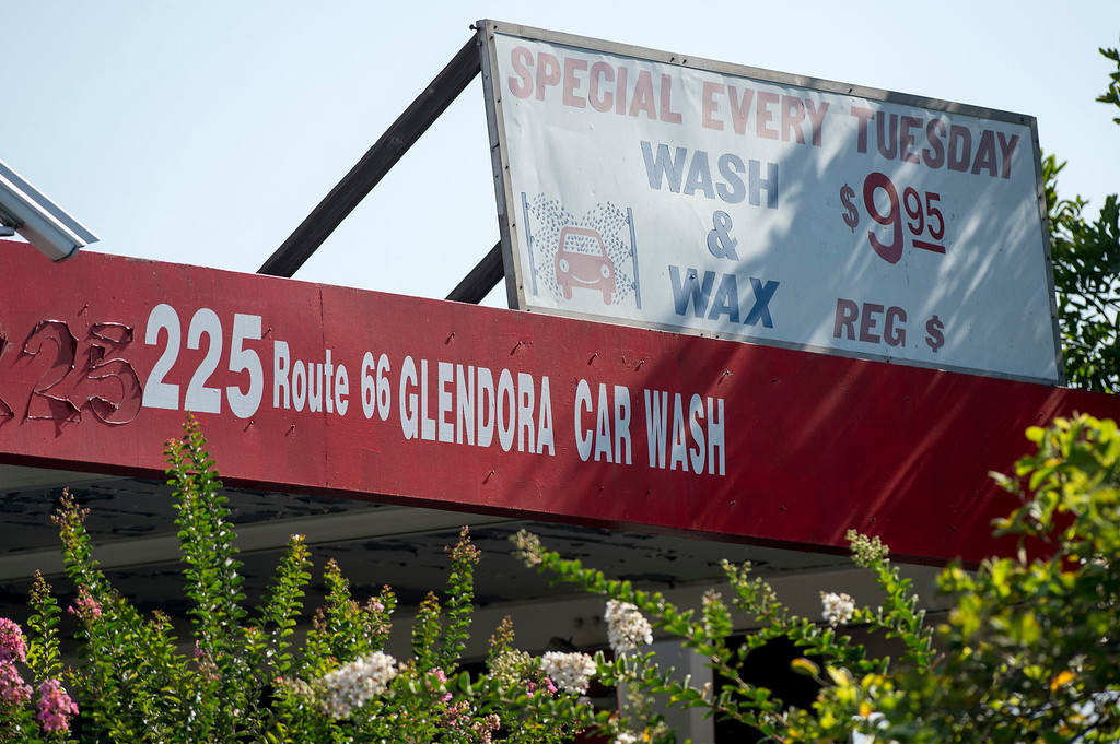 . Police investigate a double homicide that left two homeless men stabbed to death at a car wash at Route 66 and Vermont Avenue in Glendora August 15, 2013.  The two men were sleeping overnight at the car wash when the stabbing occurred about 2 a.m.   (SGVN/Staff photo by Leo Jarzomb)