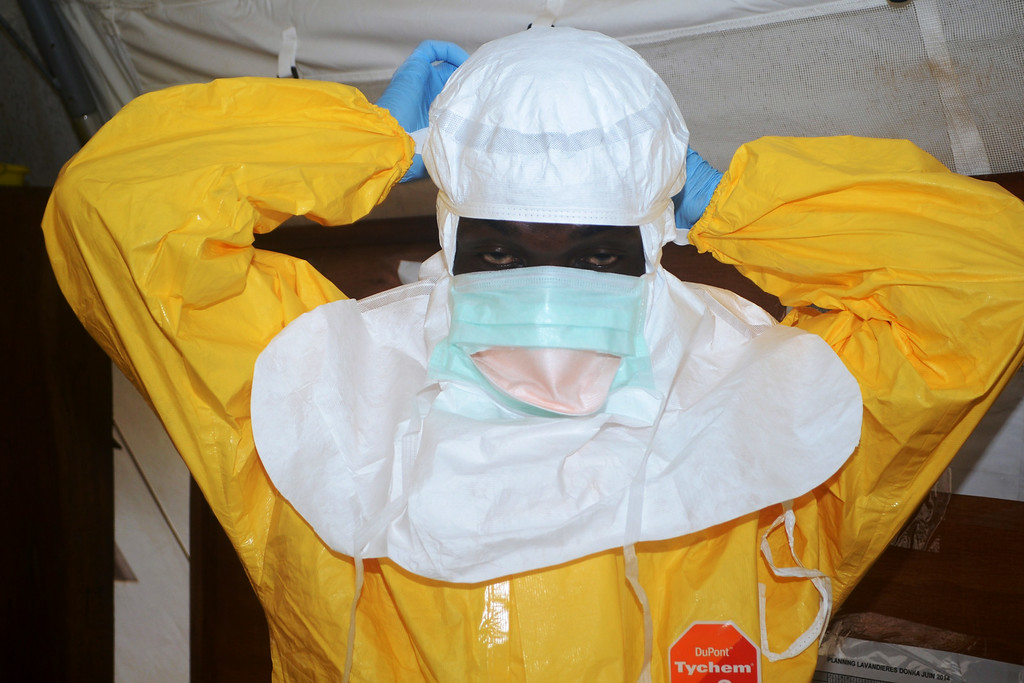 . A picture taken on June 28, 2014 shows a member of Doctors Without Borders (MSF) putting on protective gear at the isolation ward of the Donka Hospital in Conakry, where people infected with the Ebola virus are being treated. The World Health Organization has warned that Ebola could spread beyond hard-hit Guinea, Liberia and Sierra Leone to neighbouring nations, but insisted that travel bans were not the answer. To date, there have been 635 cases of haemorrhagic fever in Guinea, Liberia and Sierra Leone, most confirmed as Ebola. A total of 399 people have died, 280 of them in Guinea.      (CELLOU BINANI/AFP/Getty Images)