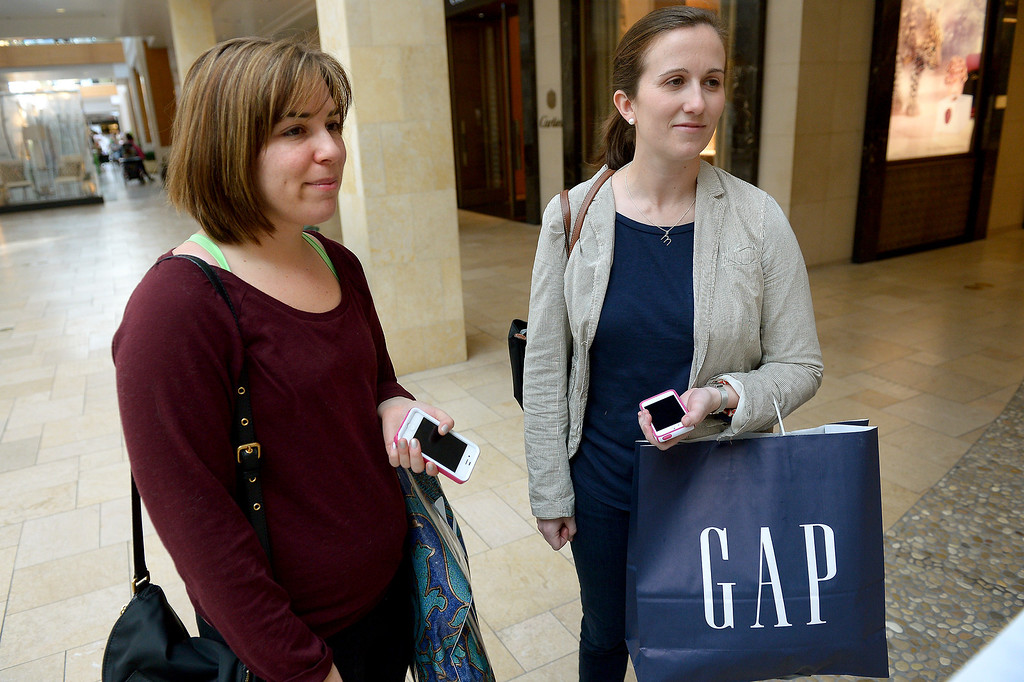 . Nicole Lustig, left, and Melissa Lewis have gone shopping together at the Westfield Topanga on the day after Christmas for 18 years, except for 2008 when Lewis couldn\'t return from Afghanistan while serving in the Army. (Photo by Michael Owen Baker/L.A. Daily News)