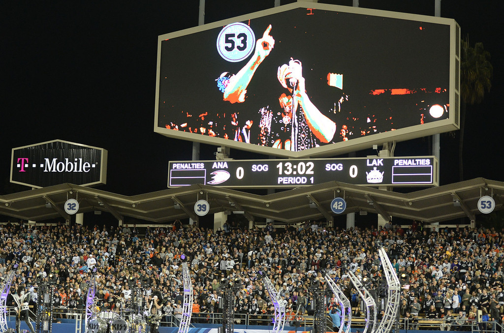 . Paul Stanley of KISS performs with the backdrop of Los Angeles Dodgers and hall of fame pitcher Don Drysdale retired number (53) prior to the inaugural NHL Stadium Series game between the Anaheim Ducks and the Los Angeles Kings at Dodger Stadium in Los Angeles on Saturday, Jan. 25, 2014. (Keith Birmingham Pasadena Star-News)