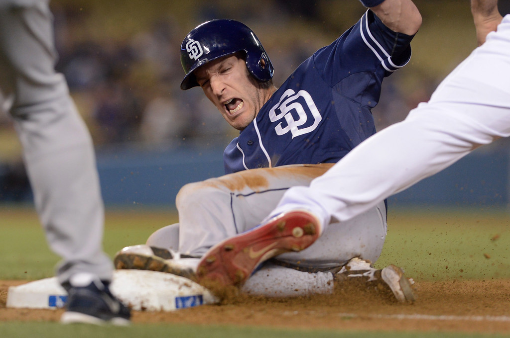 . Padres Chris Denorfia is picked off first base on a throw by Dodger right fielder Yasiel Puig to end the game June 3, 2013 in Los Angeles, CA.(Andy Holzman/Staff Photographer)