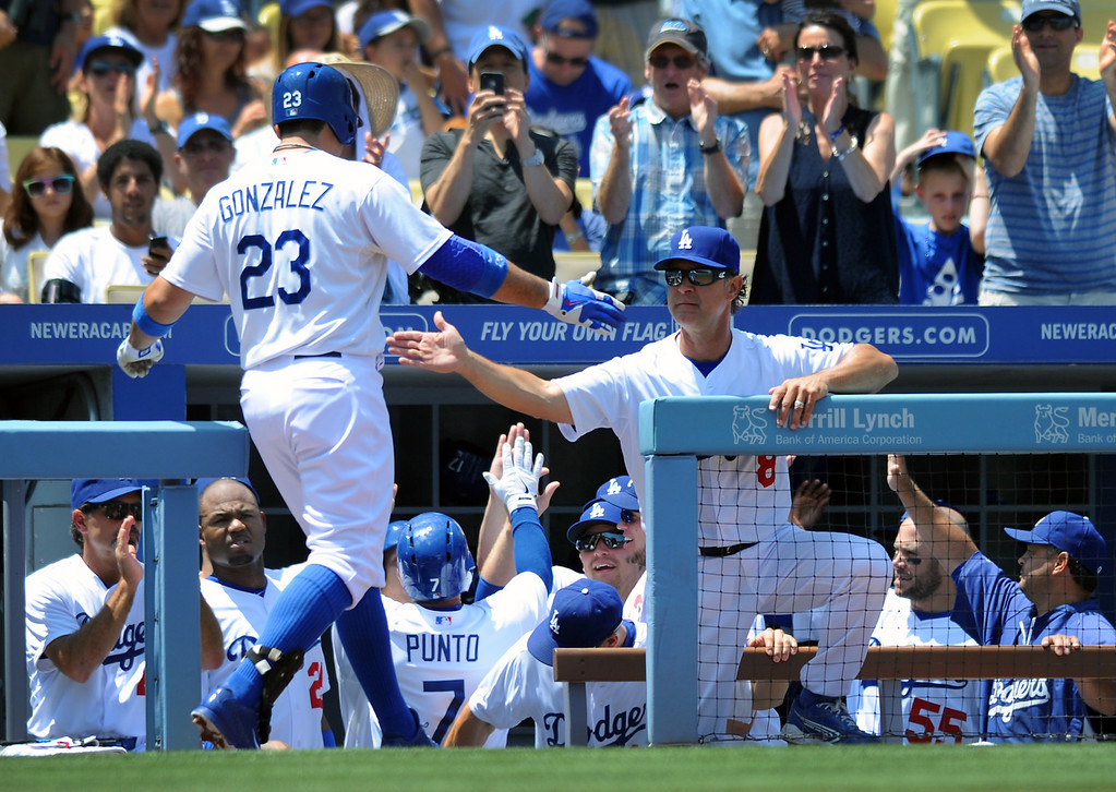 . The Dodgers\' Adrian Gonzalez is congratulated by manager Don Mattingly after hitting a two-run homer in the first inning against the Rays. Saturday, August 10, 2013, at Dodger Stadium. Dodgers won 5-0.   (Michael Owen Baker/L.A. Daily News)