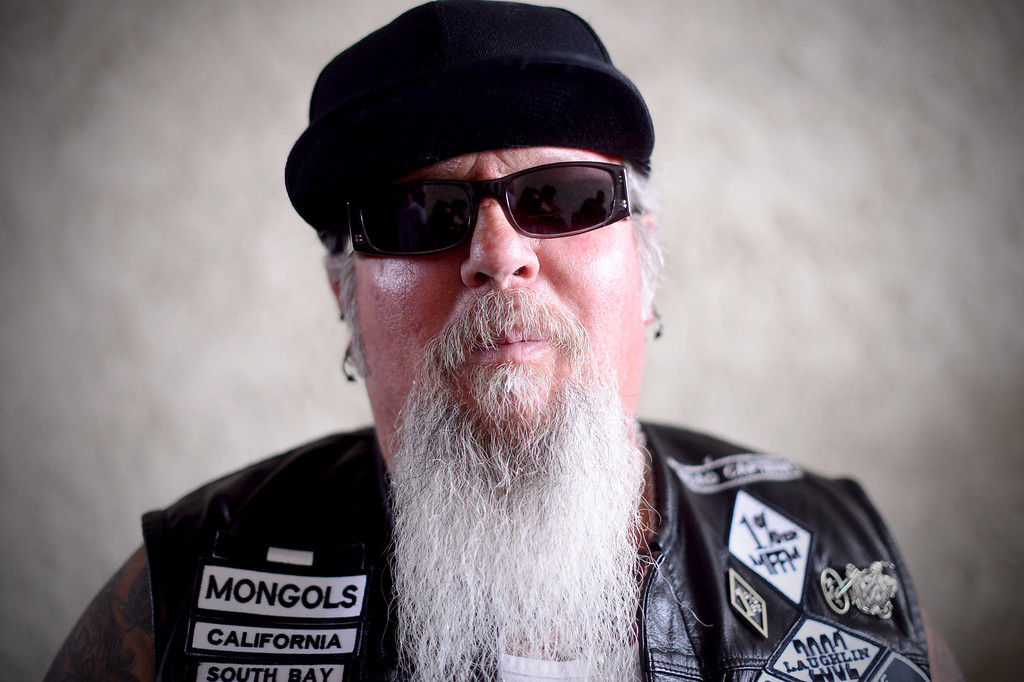 . Rags, of the South Bay Chapter of the Mongols, poses as motorcycle club members rally Saturday, March 29, 2013 at The House Lounge in Maywood in support of the Mongols who are facing a federal trial seeking to take away their trademark patch. (Photo by Sarah Reingewirtz/Pasadena Star-News)