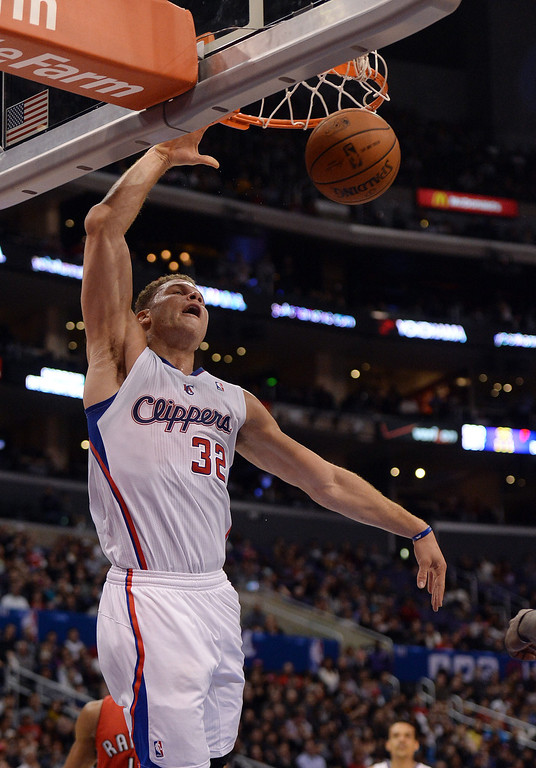 . The Clippers� Blake Griffin #32 dunks the ball during their game against the Raptors at the Staples Center in Los Angeles Friday, February 7, 2014. (Photo by Hans Gutknecht/Los Angeles Daily News)