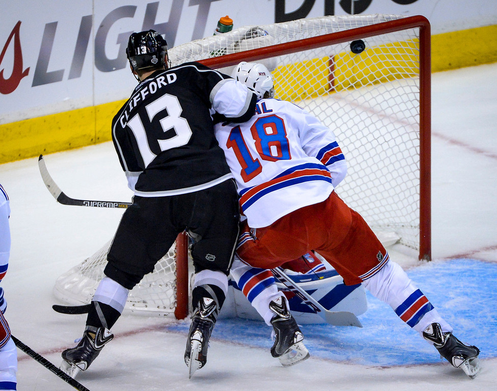 . Kings Kyle Clifford scores on Rangers goalie Henrik Lundqvist as Rangers Marc Staal helps defend on the play during first period action at Game 1 of the Stanley cup Finals at Staples Center Wednesday, June 4, 2014 ( Photo by David Crane/Los Angeles Daily News )