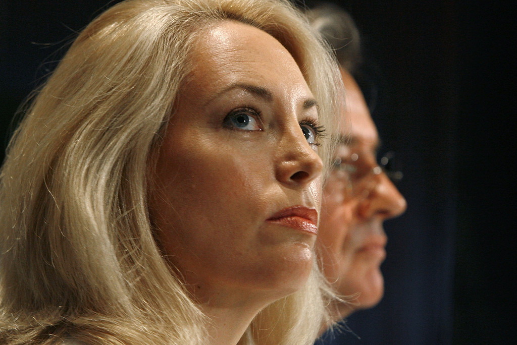 ". WASHINGTON - JULY 14:  Retired CIA employee Valerie Plame Wilson (L) and her husband, former diplomat Joe Wilson, hold a press conference where they announced a lawsuit against senior members of the Bush Administration at the National Press Club July 14, 2006 in Washington, DC. Plame filed suit in U.S. District Court July 13, 2006, charging that Vice President Dick Cheney, his aide, I Lewis ""Scooter\"" Libby, and presidential advisor Karl Rove destroyed her career when they leaked her identity to the press.   (Photo by Chip Somodevilla/Getty Images)"