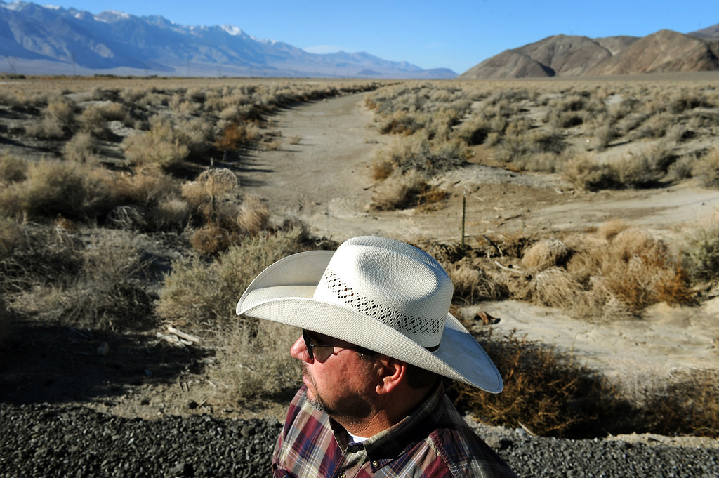 . Rancher Mark Lacey stands by an irrigation ditch that dried up after the construction of the L.A. Aqueduct.  Lacey is a fourth-generation rancher in the Owens Valley who leases land from the DWP for his cattle. (Photo by Michael Owen Baker/L.A. Daily News)