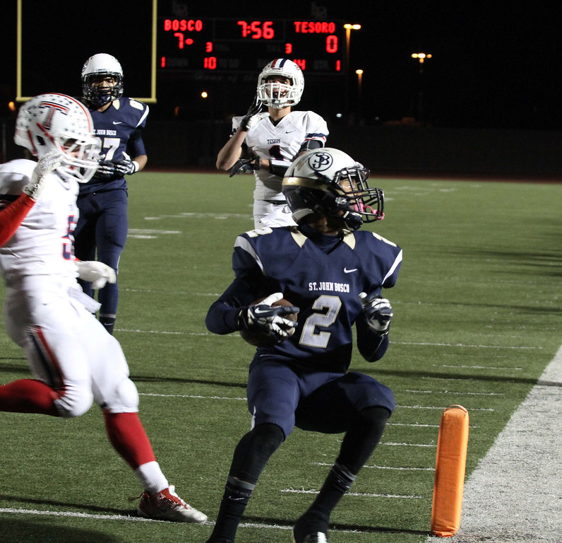 . November 22, 2013-Photo by Tracey Roman/for the Press-Telegram  St. John Boscos Jaleel Wadood scores a second touchdown for the Braves as they take on Tesoro Friday night.