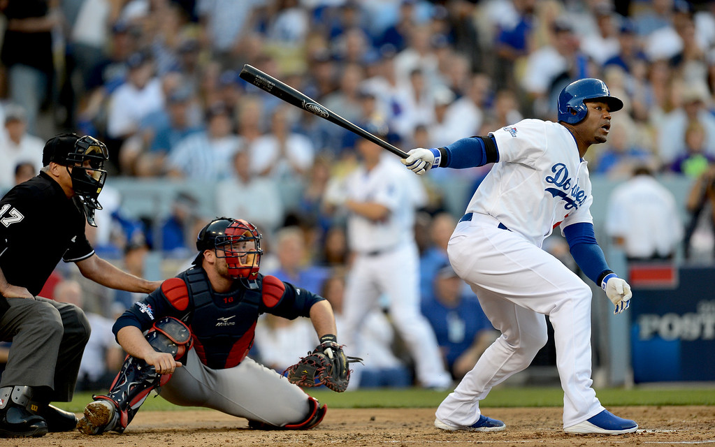 . Los Angeles Dodgers\' Carl Crawford hits a 3-run home in the second inning during game 3 of the NLDS at Dodger Stadium Sunday, October 6, 2013. (Photo by Hans Gutknecht/Los Angeles Daily News)