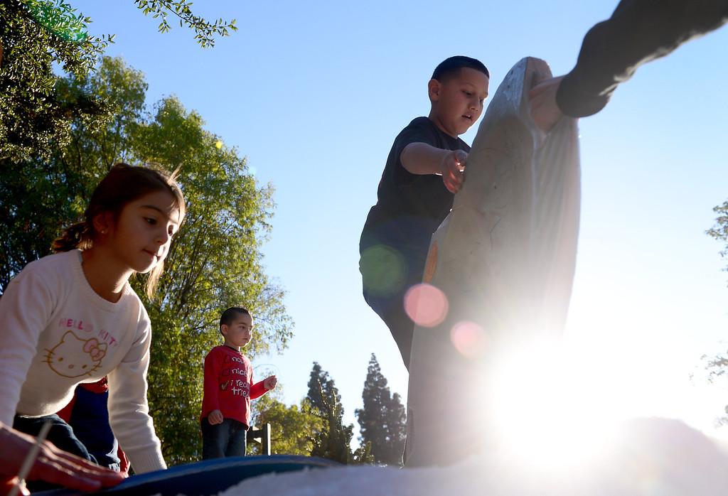 . Children go sledding during Montebello\'s annual Winter Wonderland at Montebello City Park Saturday, December 14, 2013. (Photo by Sarah Reingewirtz/Pasadena Star-News)