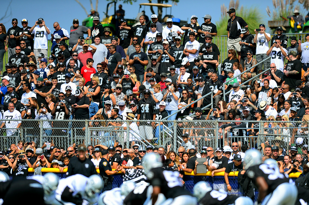 . Raider fans watch the Cowboys-Raiders practice in Oxnard, Wednesday, August 13, 2014. (Photo by Michael Owen Baker/Los Angeles Daily News)
