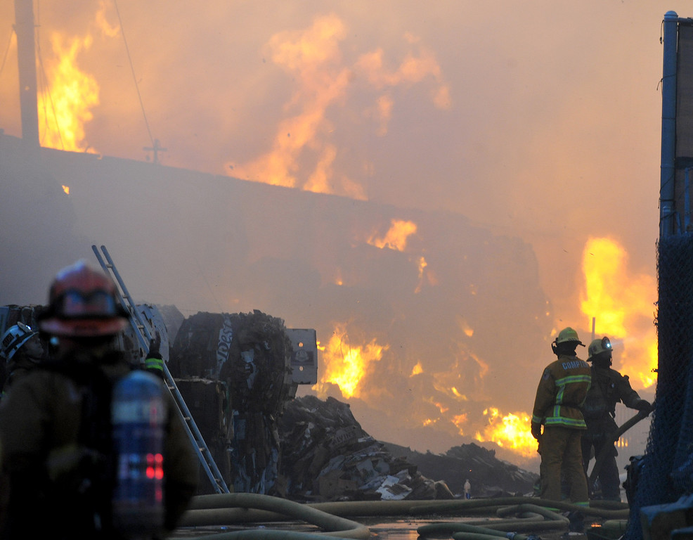 . Firefighters battle a massive fire at the Pan Pacific Fiber, Inc. recycling plant 9n the 14000-block of Marquardt Ave. in Santa Fe Springs. (Staff Photo by Keith Durflinger/Whittier Daily News)