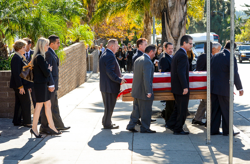 . The body of Joseph Gatto is transported to a hearse after services at Our Mother of Good Counsel Catholic church as his son, California Assemblyman Mike Gatto and wife Danielle follow on Monday November 25, 2013.  Joseph Gatto was found dead in his Silver Lake home on November 13th.    ( Photo by David Crane/Los Angeles Daily News )