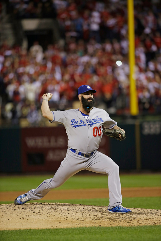 . Los Angeles Dodgers relief pitcher Brian Wilson throws during the ninth inning of Game 1 of the National League baseball championship series against the St. Louis Cardinals, Friday, Oct. 11, 2013, in St. Louis. (AP Photo/David J. Phillip)