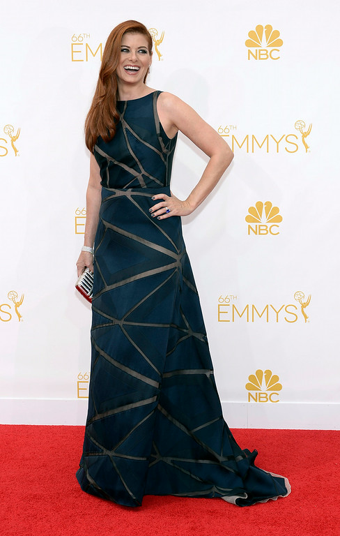 . Debra Messing on the red carpet at the 66th Primetime Emmy Awards show at the Nokia Theatre in Los Angeles, California on Monday August 25, 2014. (Photo by John McCoy / Los Angeles Daily News)