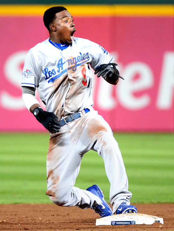 . Dodgers\' pinch runner Dee Gordon is surprised he was called out at second and replays showed he may have slid under the tag in the ninth during their 4-3 loss to the Braves Friday, October 4, 2013 at Turner Field in Atlanta, Georgia. Atlanta Braves\' Andrelton Simmons tagged him. (Photo by Sarah Reingewirtz/Pasadena Star- News)