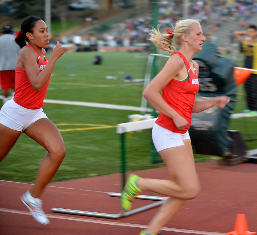 . 05-03-2013-(LANG Staff Photo by Sean Hiller)-  The Bay League track and field finals Friday night at Mira Costa High School. Redondo\'s  Cara Ulizi, left, won the girls varsity 800 and Kayla Ferron, right, took third.