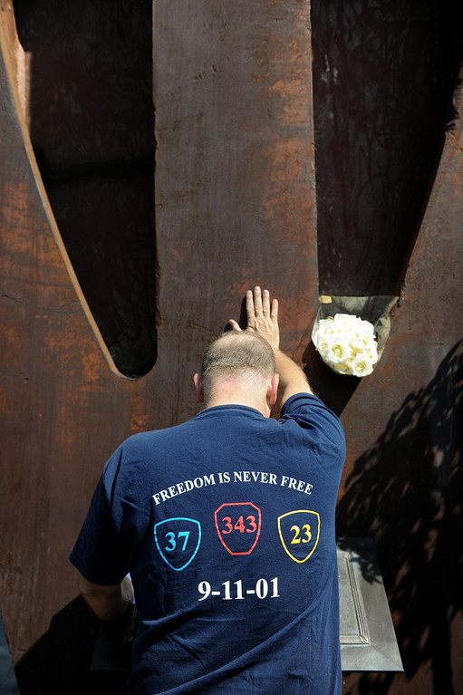 . Guy Cenname, of the American Red Cross, pays respect at the 9/11 Remembrance Ceremony at the World Trade Center Memorial at LAFD Frank Hotchkin Memorial Training Center, Thursday, September 11, 2013. (Photo by Michael Owen Baker/L.A. Daily News)
