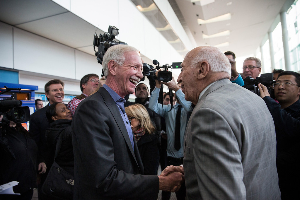 """. NEW YORK, NY - JANUARY 15:  Chesley \""""Sully\"""" Sullenberger (L), a retired airline captain famous for landing a commercial jet on the Hudson River, shakes hands with Arthur Imperatore, founder of New York Waterway, at a press conference celebrating the five year anniversary of \""""The Miracle on the Hudson\""""  on January 15, 2014 in New York City. On January 15, 2009, Sullenberger took off from La Guardia airport while piloting US Airways Flight 1549 with 150 passengers and five crew members. The plane hit a goose shortly after take off, forcing Sullenberger to land the plane in the Hudson River; no one was killed.  (Photo by Andrew Burton/Getty Images)"""