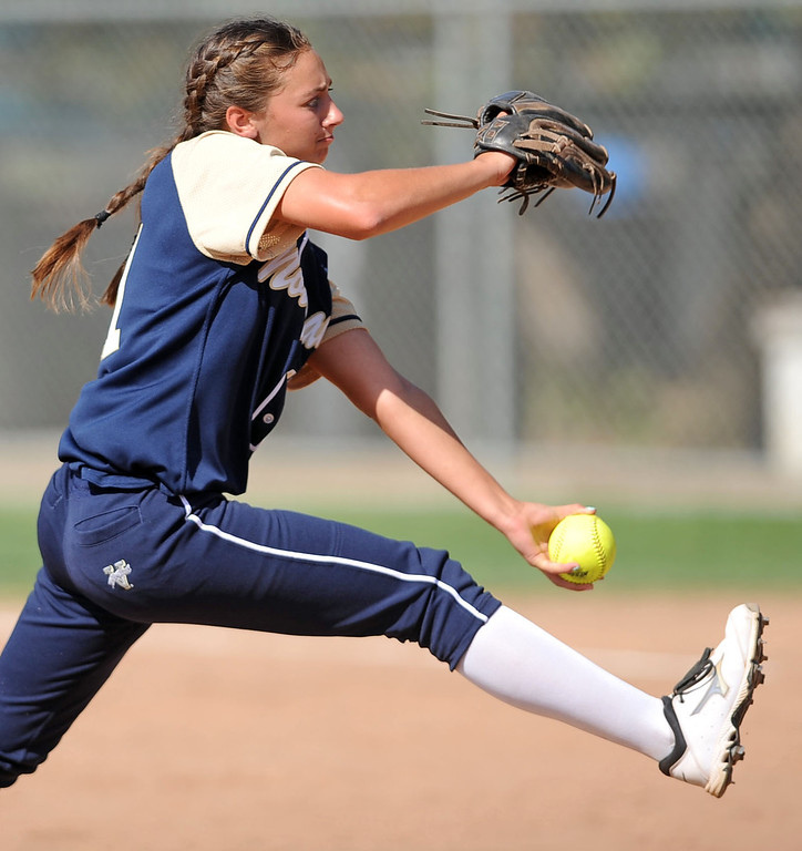. Notre Dame\'s Dani East delivers a pitch against Alemany during their Mission League softball showdown in Encino, CA April 8, 2014.  Alemany won the game, 5-4.(Andy Holzman/Los Angeles Daily News)