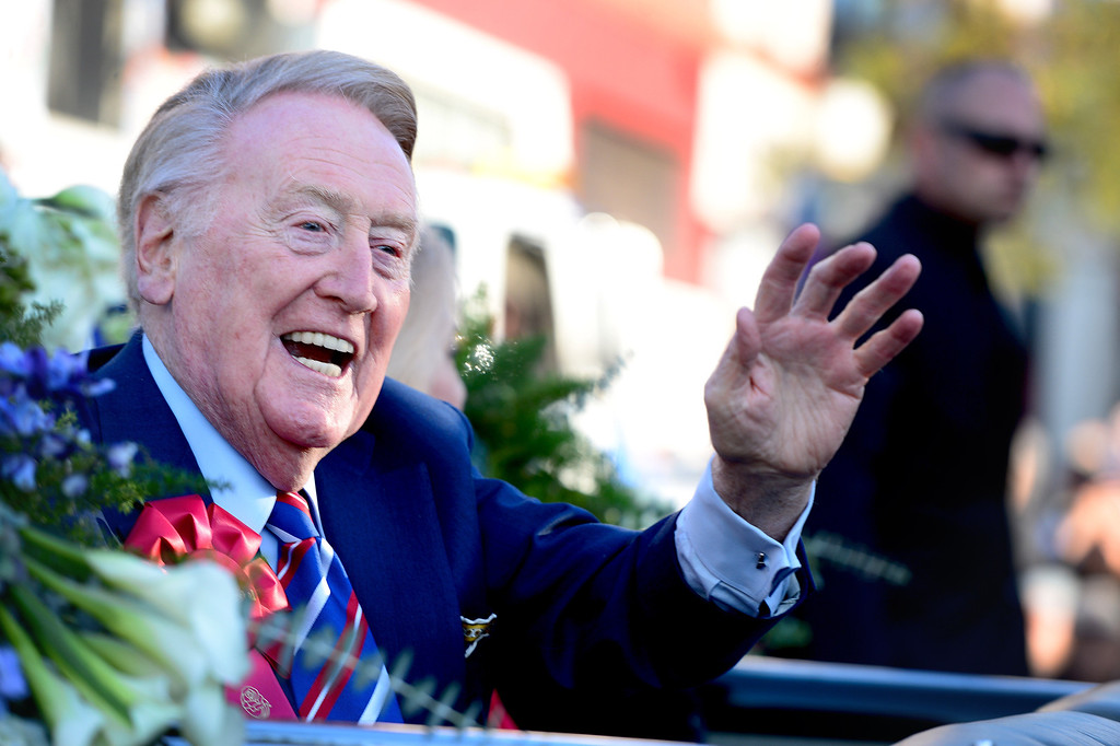 . Parade Grand Marshall and voice of the Los Angeles Dodgers Vin Scully rides in a 1950 Oldsmobile 98 Coupe Convertible during the 125th Rose Parade in Pasadena, CA January 1, 2014. (Photo by Sarah Reingewirtz/Pasadena Star-News)