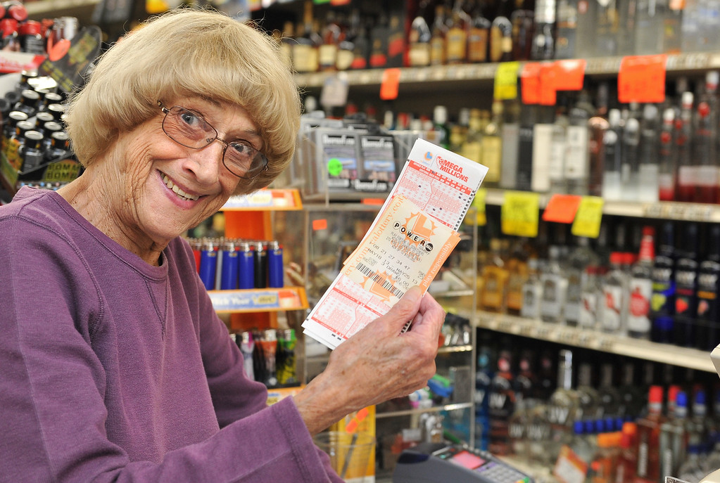 . 5/17/13 - Sandi McGrath has her numbers for Powerball at Dick\'s Palm Tree Liquor Food Mart in Long Beach. McGrath purchased three Powerball tickets and will use the winning to buy 11 houses for her grandchildren, then donate to charity and help others in need. The jackpot for Saturdays drawing is at $550 million. Photo by Brittany Murray / Staff Photographer