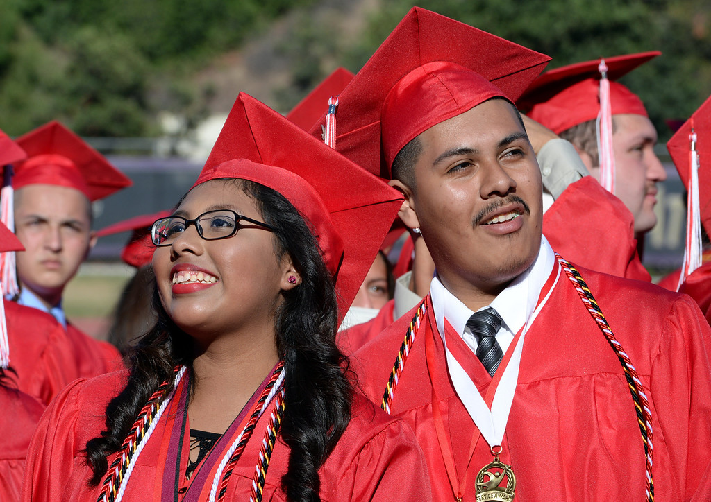 . Students look toward the stands as family and friends cheer during the Whittier High School graduation at Whittier College in Whittier, Calif., on Wednesday, June 4, 2014.  (Keith Birmingham/Pasadena Star-News)