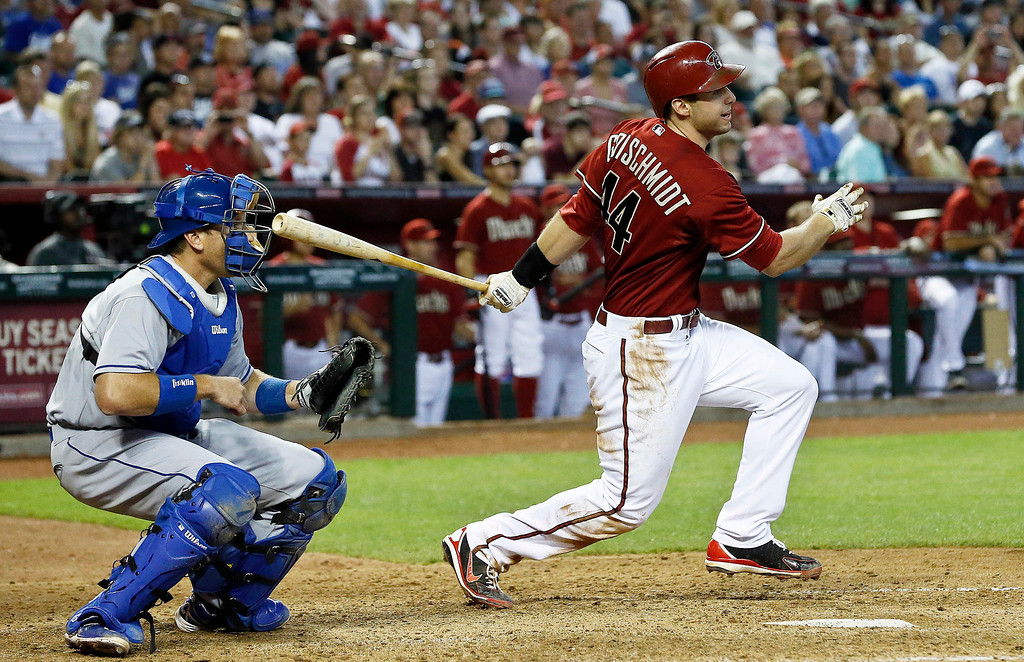 . Arizona Diamondbacks\' Paul Goldschmidt, right, connects on the game-winning hit as Los Angeles Dodgers\' A.J. Ellis looks on during the ninth inning in a baseball game, on Sunday, April 14, 2013 in Phoenix.  The Diamondbacks defeated the Dodgers 1-0. (AP Photo/Ross D. Franklin)