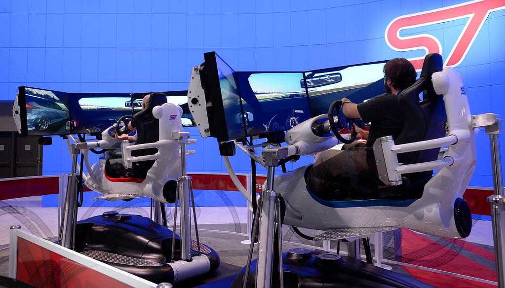 . Nov 20,2013 Los Angeles CA. USA. Media people get to try out the ST racing games at the FORD booth, during the 2013 Los Angeles Auto Show. Photo by Gene Blevins/LA Daily News