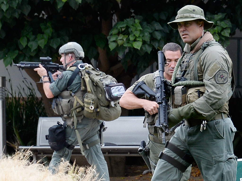 . SANTA MONICA, CA - JUNE 07:  Los Angeles County SWAT team members search the grounds of Santa Monica College near the library after multiple shootings  were reported on the campus June 7, 2013 in Santa Monica, California.  According to reports, at least three people have been injured, and a suspect was taken into custody. (Photo by Kevork Djansezian/Getty Images)