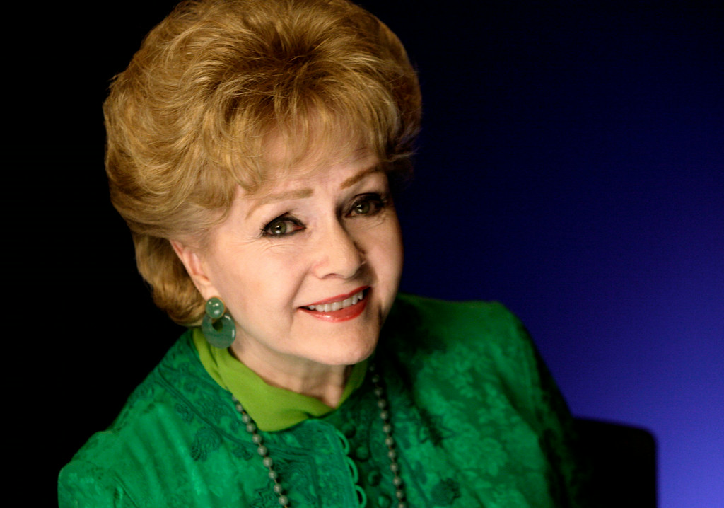 . This Oct. 14, 2011 file photo shows actress Debbie Reynolds posing for a portrait in New York.  (AP Photo/Richard Drew, file)