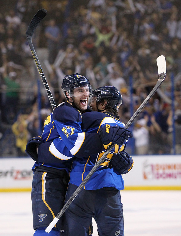 . Blues defenseman Alex Pietrangelo, left, embraces teammate Kevin Shattenkirk after scoring the tying goal in the final minute of regulation to send the game to overtime during Game 5 of the Western Conference quarterfinals between the St. Louis Blues and the Los Angeles Kings on Wednesday, May 8, 2013, at the Scottrade Center in St. Louis. (AP Photo/St. Louis Post-Dispatch, Chris Lee)