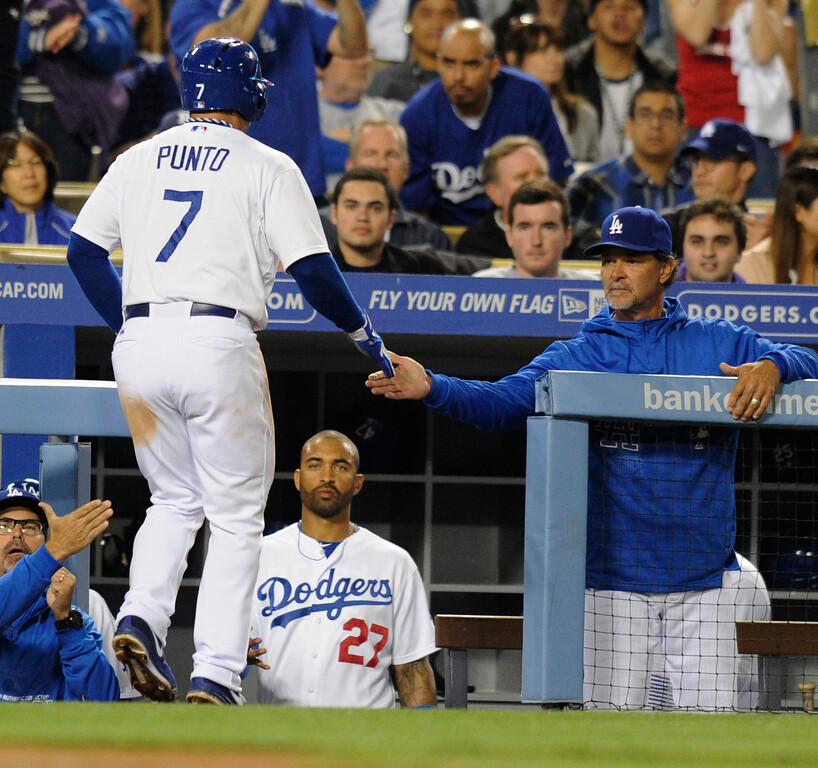 . Nick Punto is congratulated by Don Mattingly after he scored on a wild pitch in the 3rd inning. The Los Angeles Dodgers played host to the Colorado Rockies in a game at Dodger Stadium in Los Angeles, CA 5/1/2013(John McCoy/Staff Photographer)