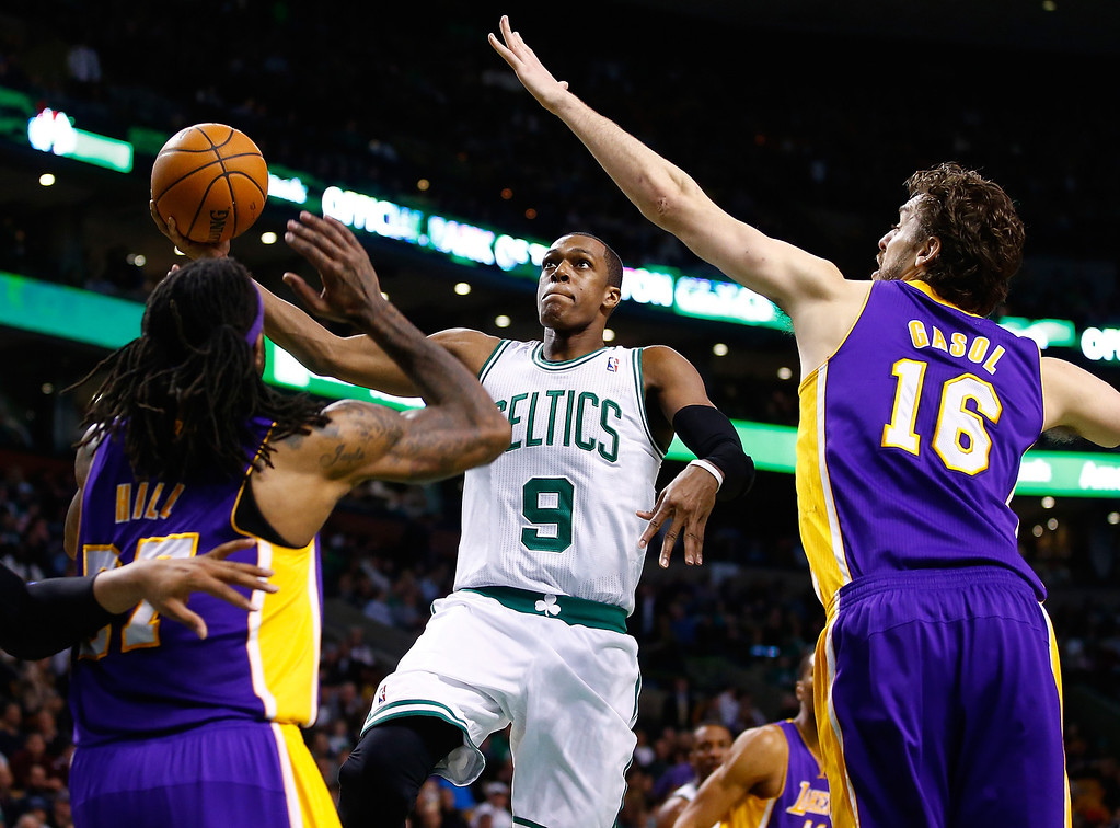 . BOSTON, MA - JANUARY 17: Rajon Rondo #9 of the Boston Celtics goes up for a layup in front of Pau Gasol #16 of the Los Angeles Lakers in the second quarter during the game at TD Garden on January 17, 2014 in Boston, Massachusetts.   (Photo by Jared Wickerham/Getty Images)