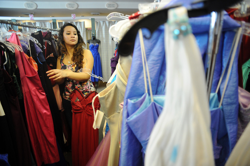 . Jennie Morales, 18, looks for a prom dress at the Assistance League of Los Angeles in Hollywood Thursday, March 6, 2014. Operation School Bell Prom Day program outfitted 56 low-income and homeless high school girls from 17 LAUSD schools with dresses, shoes and other accessories so they can attend their proms.(Photo by Hans Gutknecht/Los Angeles Daily News)