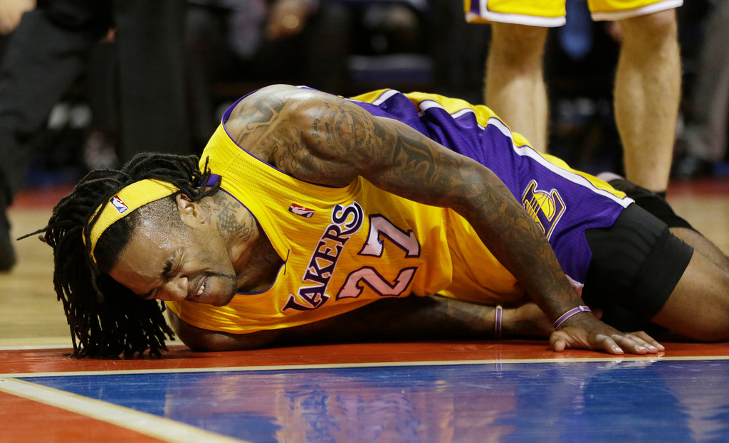 . Los Angeles Lakers center Jordan Hill (27) reacts after falling to the floor during the second half of an NBA basketball game against the Detroit Pistons at the Palace in Auburn Hills, Mich., Friday, Nov. 29, 2013. (AP Photo/Carlos Osorio)