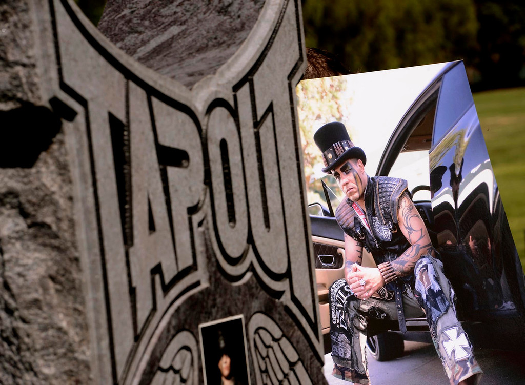 . A granite monument was unveiled for Tapout founder and San Bernardino resident Charles Lewis Jr. at Mountain View Cemetery in San Bernardino, CA on Saturday September 7, 2013.  Lewis was killed by a drunk driver in March of 2009.  (Photo by Gabriel Luis Acosta/San Bernardino Sun)