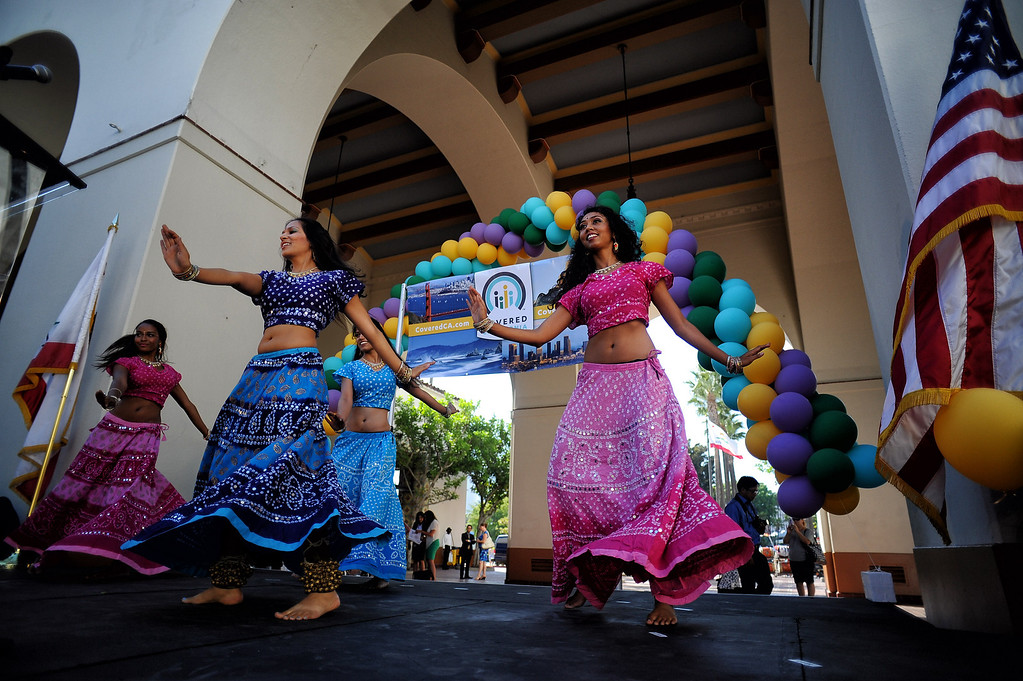 . Bollywood Dance Company dancers perform during a rally for Covered California, the state run market exchange for health care insurance at Union Station in Los Angeles Tuesday, October 1, 2013. The rally was held to help kick off open enrollment for those eligible uninsured who qualify to enroll in affordable health care.(Photo by Hans Gutknecht/Los angeles Daily News)