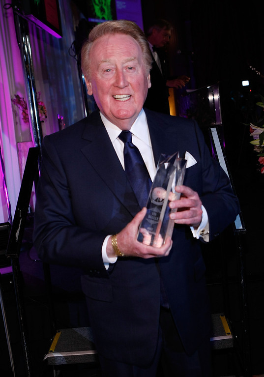 . Los Angeles Dodger announcer Vin Scully receives the AMEE Award in Broadcasting during the 2009 AFTRA Media and Entertainment Excellence Awards at the Biltmore Hotel on March 9, 2009 in Los Angeles, California.  (Photo by Michael Buckner/Getty Images)