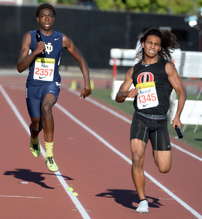 . Notre Dame\'s Christian Pikes, left, along with Great Oak\'s Damion Marshall competes in the 4x200 Invitational during the Arcadia Invitational track and field meet at Arcadia High School in Arcadia, Calif., on Friday, April 11, 2014. Rocky Mountain won the race as Redondo Union finished second. (Keith Birmingham Pasadena Star-News)