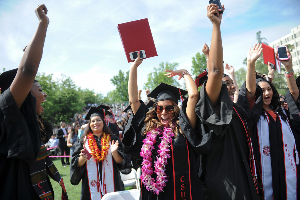 . Graduates cheer at the end of the CSUN the commencement ceremony, Tuesday, May 21, 2013. (Michael Owen Baker/L.A. Daily News)
