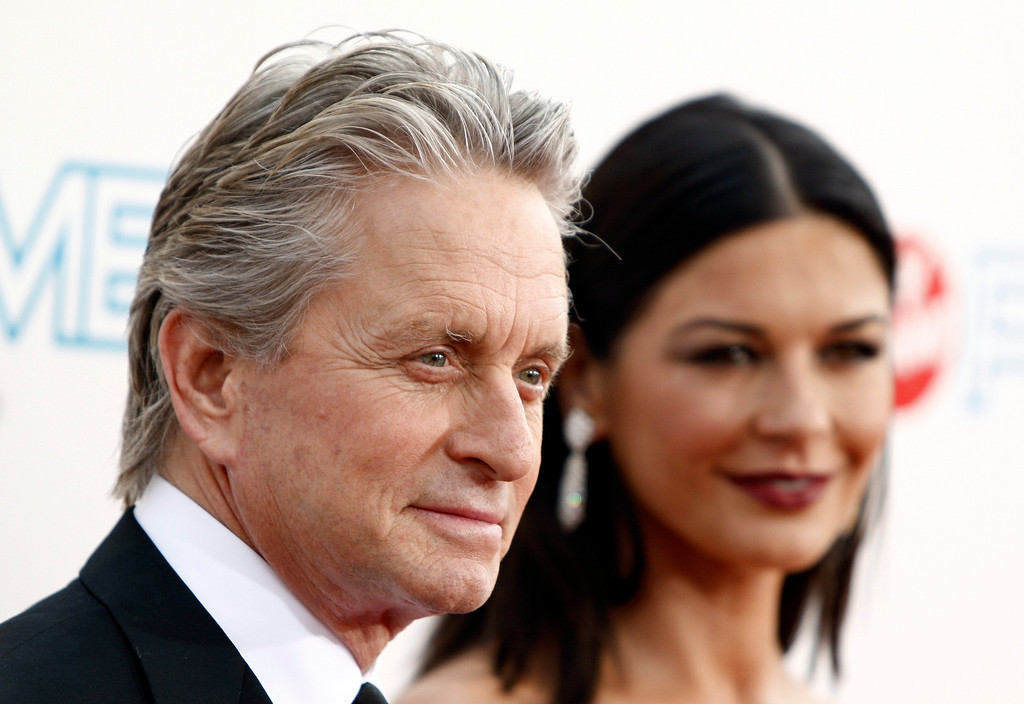 . Actors Michael Douglas, left, and Catherine Zeta-Jones arrive at the taping of the American Film Institute Life Achievement Awards honoring Douglas in Culver City, Calif. on Thursday, June 11, 2009. (AP Photo/Matt Sayles)