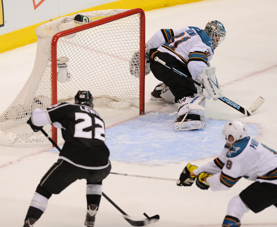 . The Kings\' Trevor Lewis shoots the game-winning goal past Sharks\' goalkeeper Antti Niemi late in the third period. (Michael Owen Baker/Staff Photographer)