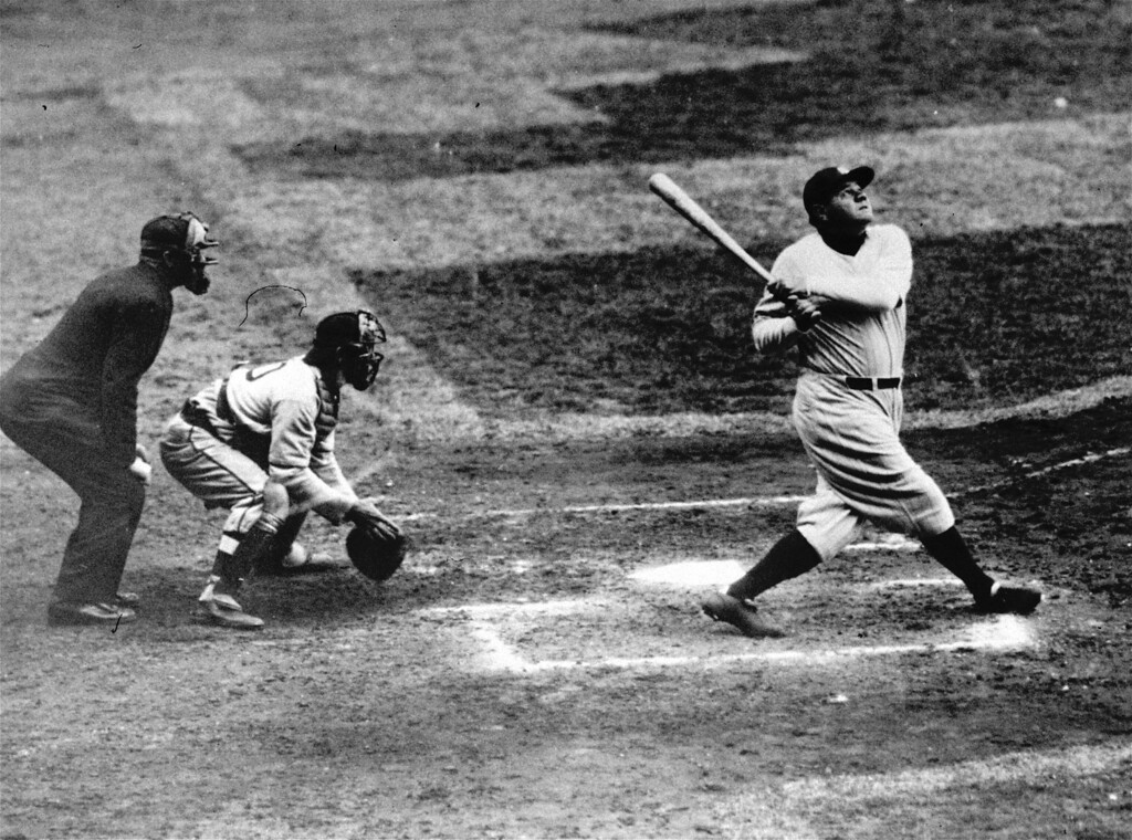 . Babe Ruth of the New York Yankees clouts a towering home run in this undated photo. (AP Photo)