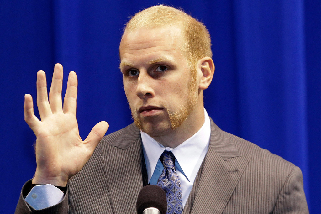 . New Dallas Mavericks center Chris Kaman waves during an NBA basketball news conference introducing new Mavericks players at American Airlines Center in Dallas, Monday, Sept. 10, 2012. (AP Photo/LM Otero)